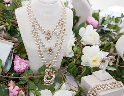 """Antique look"" accessories make a bold statement with large rhinestones and pearls."